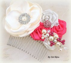 ***Made Upon Request This bridal comb was created for a bride whose wedding colors were hot pink and ivory. The focal point is a handmade multi-petal flower made with ivory satin. The center has been embellished with a pretty crystal and pearl jewel. Chiffon and satin flowers in hot pink and ivory complement the main bloom. My signature cluster of pearls and crystals complete this exquisite and vibrant hair piece. The arrangement sits on a silver comb. ***Are you looking for a specific…