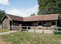 This stable block includes twostables, covered walkway, tack room, feed room and implement store. The overhang is 1.2m and includes support posts and curved angle braces at both ends. Lshape stable blocks create a more compact working area and provide greater protection from the elements. Top stable doors were added to the rear of the …