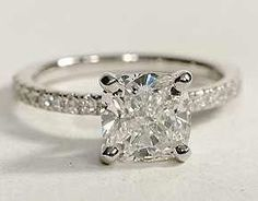 This is EXACTLY what I want. Princess Solitaire with skinny diamond band.