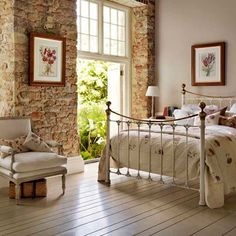 Exposed brick walls form a delightful contrast to the soft femininity of this French style bedroom. Brick Wall Bedroom, Brick Wall Decor, Bed Wall, Window Wall, Style At Home, Home Bedroom, Bedroom Decor, Garden Bedroom, Bedroom Rustic