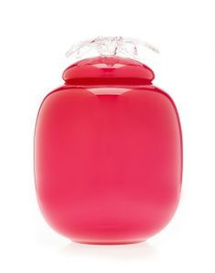 Flores Pink. Hand crafted in a vibrant pink hue with glass flower flourishing over the lid. Hand made in Czech Republic by Pieta Verre.