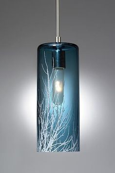 """""""Winter Branch Pendant"""" by Moshe Bursuker. Image Pendant lights are hand blown and carved glass. The images are taken by the artist and etched onto the surface of the glass. Installation is simple and all hardware is provided including a canopy for the ceiling. Each piece is unique and will vary from piece to piece."""