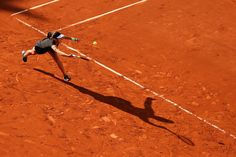 Ana Ivanovic Photos Photos - Ana Ivanovic of Serbia plays a forehand in her Women's Singles match against Yaroslava Shvedova of Kazakhstan on day one of the 2015 French Open at Roland Garros on May 24, 2015 in Paris, France. - 2015 French Open - Day One