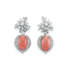 A PAIR OF DIAMOND AND CORAL EAR PENDANTS: Each suspending an oval coral cabochon, within a double-row circular-cut surround, to the marquise, pear and baguette-cut diamond cluster surmount of floral. Coral Earrings, Coral Jewelry, Diamond Jewelry, Diamond Earing, Brighton Jewelry, Designer Earrings, Luxury Jewelry, Jewelry Stores, Vintage Jewelry