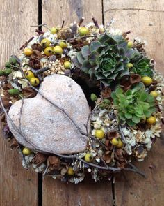 .I love how they incorporated the heart into this succulent wreath.  Lovely