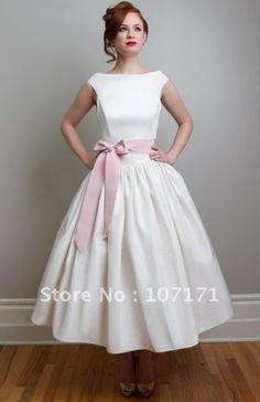 short wedding dress with a pink bow. Mini Moon?