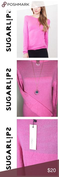 Sugar Lips Long Sleeve Pink Knit Sweater 🎀NWT🎀 Sugar Lips Long Sleeve Pink Knit Sweater - Delicate beautiful (SO Soft) Sweater 🎀NWT🎀 54% Rayon 46% Nylon Amazing Quality.  Two sizes available: S/M (NWOT) & M/L (NWT).  Small pull on the inside of M/L sweater not visible on the outer layer that shows. See picture.   You'll LOVE this Top! Light and Cozy all at once with lovely design detail around the collar, base and throughout. Sugarlips Sweaters Crew & Scoop Necks
