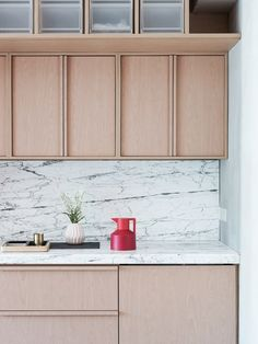 #kitchen | framing of overheads with handle as frame on base cabinets - kh