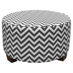 """Cocktail ottoman with chevron motif. Handmade in the USA.Product: OttomanConstruction Material: Wood and fabric  Color: Charcoal  Features:Handmade in the USAPlush foam padding for added comfort Dimensions: 18"""" H x 31"""" DiameterCleaning and Care: Spot clean only"""