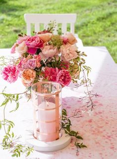 Pretty in pink: Fresh roses and blackberry stems make a beautiful Mother's Day centerpiece. More Mother's Day ideas: http://www.midwestliving.com/holidays/easy-mothers-day-decorations/?page=16