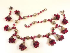 Unsigned Miriam Haskell cranberry glass bib necklace and earrings