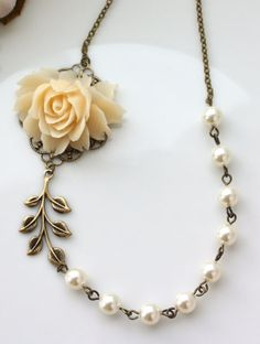 An Ivory Large Rose Flower Ivory Pearls, Brass Leaf Necklace. Wedding Bridal. Vintage Inspired by Marolsha - https://www.etsy.com/listing/62703560/an-ivory-large-rose-flower-ivory-pearls?ref=shop_home_active_7