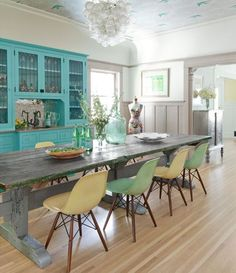 """Glamorous Housewife's"" (blog( Bright & Colorful Bungalow// I love the Turquoise Built-In...Beautiful paint job, rustic table, and worn chairs."