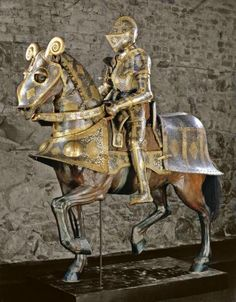 Ornate 16th-century armour for horse and knight, and typical high saddle. Royal Armoury, Stockholm