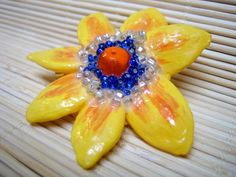 glass, crystal and pumpkin seed gold floral brooch