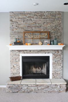 Fireplace, gray walls, white mantel & box frame