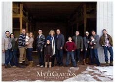 large family shot-look how good they look without matching the clothes.  all in the same tone, but not same colors.