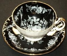AYNSLEY ENGLAND WHITE ROSE GOLD BLACK FOOTED TEA CUP AND SAUCER