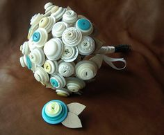 the bride and groom vintage button bouquet and boutonniere.