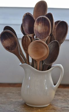 FARMHOUSE – DECOR – a collection of wooden spoons is appealing and practical for any farmhouse kitchen.