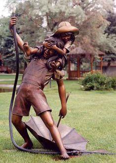 """""""Summer Shower Girls"""" sculpture by George Lundeen - photo by Lundeen Sculpture"""