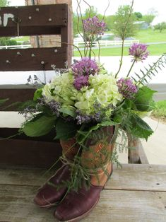 Cowboy boot arrangement for reception www.everafterfloral.com