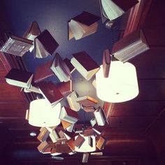 Books on the ceiling Alice in wonderland decor. Like when she is falling down the rabbit hole