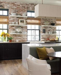 Brick Walls in Kitchens + loads of white + built in seating for dining = X
