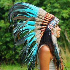 Beautiful turquoise Indian headdress made with 75cm feathers, genuine leather, and an intricate headband beadwork design perfect for costume and rave parties!