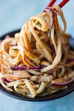 Asian Peanut Noodle Salad with Chicken, Shredded Carrots, Red Cabbage and Green Onions, in Sweet-Spicy Peanut Sauce