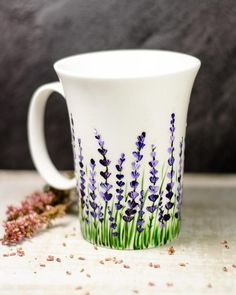 """ceramic painting Do you like the idea of enjoying your morning cup of tea amongst the flowers? If your answer is """"yes"""" be sure to check this amazing hand painted lavender coffee mug. Painted Coffee Mugs, Hand Painted Mugs, Hand Painted Ceramics, Painted Cups, Pottery Painting Designs, Pottery Designs, Mug Designs, Pottery Painting Ideas Easy, Nice Designs"""
