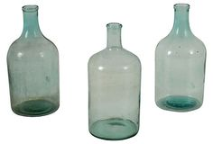"Glass Bottles, Set of 3  FOUND VINTAGE  6""L x 6""W x 13.5""H  ($600.00)  $285.00  OneKingsLane.com"