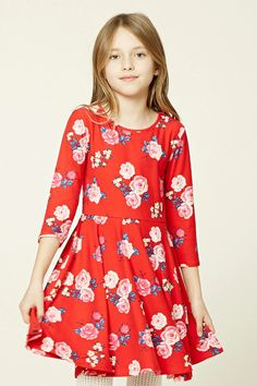 Forever 21 Girls - A soft knit swing dress featuring an allover floral print, 3/4 sleeves, and a round neckline.