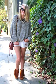 Oversized sweater + shortie shorts + fringed booties. This outfit is perfect for those in between days before summer officially kicks in!