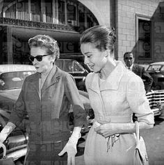 The actress Audrey Hepburn photographed with her mother, the Baroness Ella Van Heemstra, at the exit of the Hotel Hassler (on Piazza Trinità dei Monti) in Rome (Italy), on October 16, 1959.