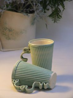 Pair of stoneware ceramic mugs in green and white on Etsy, $59.39. Great handles