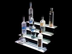 The Armana Four Tier LED Liquor Display is perfect for displaying a large number of liquor bottles or any other items you may choose to display. Bar Shelves, Display Shelves, Liquor Bottles, Vodka Bottle, Bar Displays, Bottle Display, Led Panel, Theater, Room Ideas