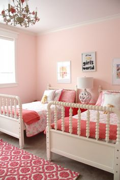 Pink Girls Bedrooms this pink girl's bedroom is so sweet! walls are covered in a