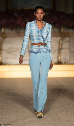 Feeling blue: A model takes to the catwalk in a gorgeous pastel trouser suit at the Matthe... S/S2015