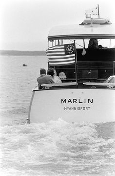 President John Kennedy & wife Jackie on their boat at their famous family's compound in Hyannis Port.
