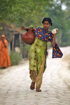 Fetching water . Ramjannagar, Bangladesh……..MOST OF US TAKE WATER FOR GRANTED…..JUST TURN ON THE FAUCET………ccp