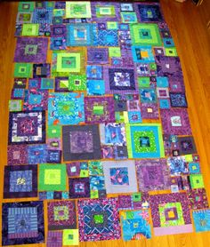 "https://flic.kr/p/8NWzyc | Purple quilt layout | I made this quilt for my 13 year old daughter. She chose the colours and the pattern, and I had so much fun with her choices! The pattern was modified from Kaffe Fassett's ""Jewel Squares Blind"" pattern in his Glorious Patchwork book. Blogged: prairiepeasant.blogspot.com/2010/10/purple-quilt-is-finis..."
