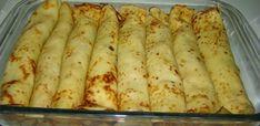 Ingredientes Para a Massa:  - 4 ovos inteiros (peneirar as gemas)  -   400 ml de leite  -  250 g de farinha de trigo peneirada  -  50 ml de azeite  -  sal a gosto  -   -   - Ingredientes Para o Recheio:  - 1 kg de peito de frango desossado  -  3 tomates sem sementes picados  -  2 cebolas picadas  -  9 dentes de alho amassados  -  ½ pimentão picado  -  1 tablete de caldo de galinha  -  1 pimenta malagueta sem sementes  -  3 colheres (sopa) de molho de soja  -  1 colher (sopa) de molho inglês…