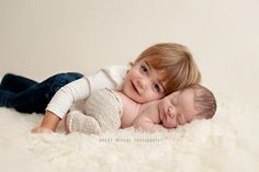 Cute picture of older sibling with newborn.