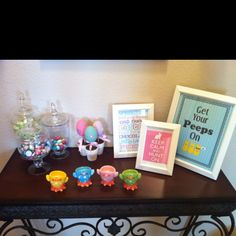 Easter Entry Table Decor...  Three Candy filled Apothecary Jars from Kirklands, Mini Egg Trees from the Christmas Tree Store $1.00 each, Egg Stands from the Christmas Tree Store for $1.29 each, 3 Frames from the Christmas Tree Store with Free Printables.