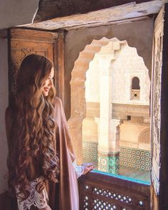 I finally got my hard drive back so prepare for some Morocco spam  Looking out from one of the classrooms at the old Ben Youssef Quran school in Marrakech  So this dress is called both an Abaya (Arabic) and Jubah (Bahasa Indonesia/Bahasa Malaysia) - thanks for those who messaged me to help me figure that out  and for those who asked how to get one, the Souks in Marrakech sell plenty of them in all different colours and styles ❤️ #morocco #marrakech