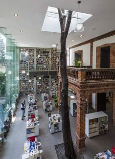 Mexican architects Fernanda Canales and Arquitectura 911sc have wrapped a concrete and glass frame around the front of an old house in Mexico City to convert the building into a library. Via Dezeen