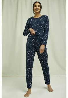 Lightweight, organic and breathable nightwear trousers. This comfortable pyjama collection is printed with an intricate galaxy design and made from the softest 100% GOTS certified organic cotton in navy and eco-white –perfect for lounging or sleeping. Made by People Tree Fair Trade producer partner Assisi. Cotton Pjs, Fair Trade Fashion, Galaxy Design, Nightwear, Organic Cotton, Women Wear, Trousers, Pajamas, Fashion Outfits