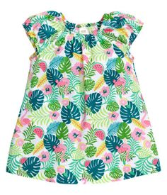Gently flared dress in soft and airy woven cotton fabric with a printed pattern. Elastication at neckline and cuffs.