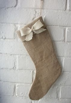 Holiday Stocking in Natural Burlap with a Bow in Ivory. $19.00, via Etsy.